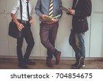 businessman standing talking.... | Shutterstock . vector #704854675