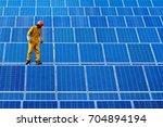 engineering man repair of solar ...   Shutterstock . vector #704894194