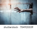 men prisoners reach out from... | Shutterstock . vector #704920339
