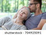 Small photo of Young loving couple supporting each other in her cancer treatment