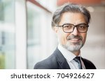 positive middle aged business...   Shutterstock . vector #704926627