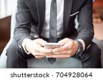 cropped view of business man... | Shutterstock . vector #704928064