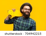 portrait of young hipster man... | Shutterstock . vector #704942215