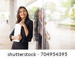a beautiful professional indian ... | Shutterstock . vector #704954395