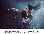 woman practices self defense | Shutterstock . vector #704955121