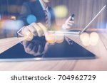 businessman pointing tablet pc... | Shutterstock . vector #704962729