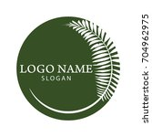 palm tree logo. resort and spa... | Shutterstock .eps vector #704962975