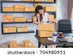 thai female working at home... | Shutterstock . vector #704980951