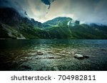 lake in mountains. fantasy and... | Shutterstock . vector #704982811