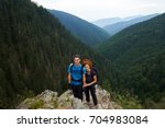 family of hikers with backpacks ... | Shutterstock . vector #704983084