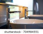 interior of bathroom with sink... | Shutterstock . vector #704984551