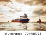 tug boat towing a tanker ship... | Shutterstock . vector #704985715