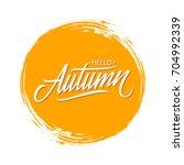 handwritten phrase hello autumn ...   Shutterstock .eps vector #704992339