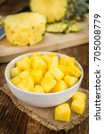 sliced pineapple on rustic... | Shutterstock . vector #705008779