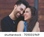 happy couple embracing leaning... | Shutterstock . vector #705031969