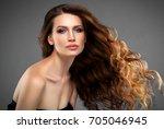 brunette hair woman. beautiful... | Shutterstock . vector #705046945