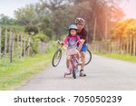 asian father and daughter... | Shutterstock . vector #705050239