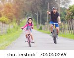 asian father and daughter... | Shutterstock . vector #705050269