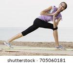 beautiful girl practising yoga... | Shutterstock . vector #705060181