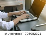 hand typing on computer laptop. | Shutterstock . vector #705082321