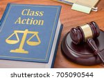 a law book with a gavel   class ... | Shutterstock . vector #705090544