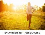 running stretching   woman... | Shutterstock . vector #705109351