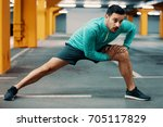 young athlete man is exercising ... | Shutterstock . vector #705117829