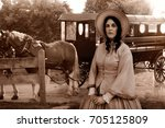 Small photo of old western woman and amish carriage