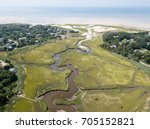 Narrow channels wind through a marsh on Cape Cod, Massachusetts. Marshes and wetlands provide flood and erosion control and furnish food and homes for fish, birds and other wildlife.