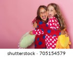 girls in colorful polka dotted... | Shutterstock . vector #705154579
