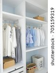 Small photo of walk -in closet with cloth and shelf at home