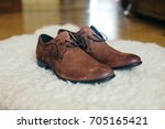 groom brown leather  shoes | Shutterstock . vector #705165421