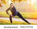 young woman stretching and... | Shutterstock . vector #705175741