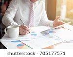 business people present to... | Shutterstock . vector #705177571