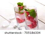 raspberry fruit water with ice... | Shutterstock . vector #705186334