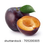 Isolated plums. whole and a...