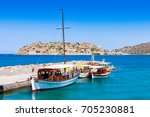 tourist and fishing boats at...   Shutterstock . vector #705230881