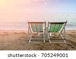 beach chair on the beach in...   Shutterstock . vector #705249001