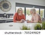 senior woman is enjoying a... | Shutterstock . vector #705249829