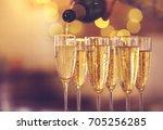 champagne glasses on gold... | Shutterstock . vector #705256285