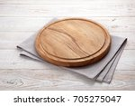 napkin and board for pizza on... | Shutterstock . vector #705275047