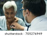 male doctor listening heart...   Shutterstock . vector #705276949
