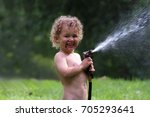 a young boy is playing with a...   Shutterstock . vector #705293641