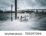 water coming over the streets... | Shutterstock . vector #705297394