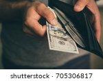 man looks in the wallet. cash.... | Shutterstock . vector #705306817