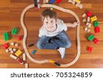 happy child playing with toys....   Shutterstock . vector #705324859