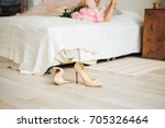 high heels shoes nearby bed | Shutterstock . vector #705326464