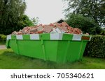loaded dumpster near a...   Shutterstock . vector #705340621