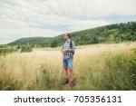 young hiker in nature  ... | Shutterstock . vector #705356131