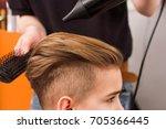 little boy getting haircut by... | Shutterstock . vector #705366445